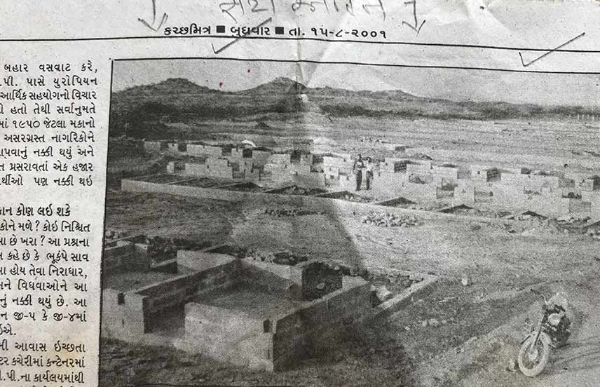 Newspaper clip of temporary shelter construction in 2001